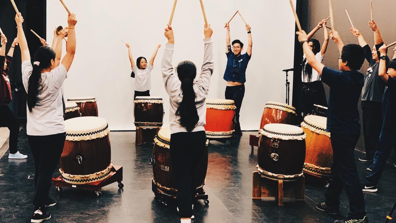 YAW Students participate in a Taiko (traditional Japanese drumming) workshop