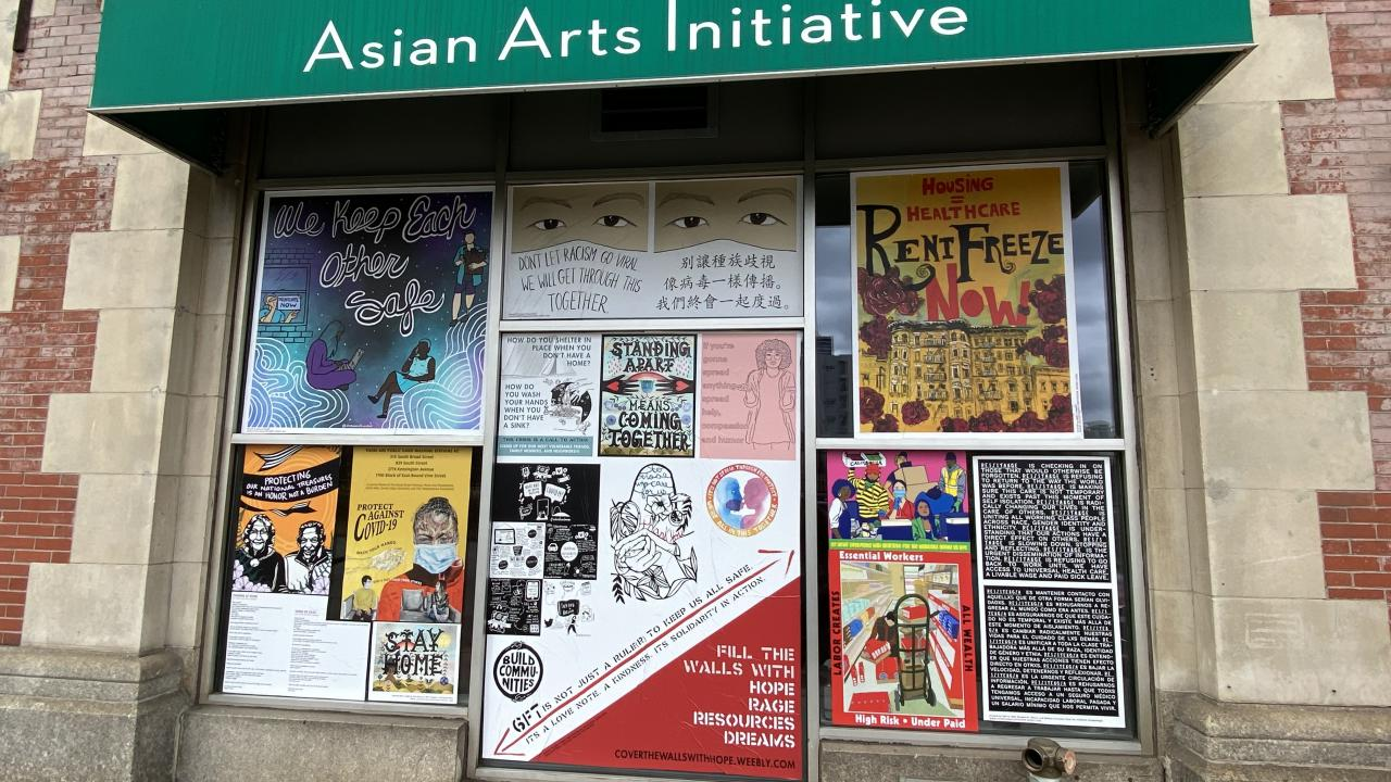 AAI's storefront covered in colorful messages of hope.