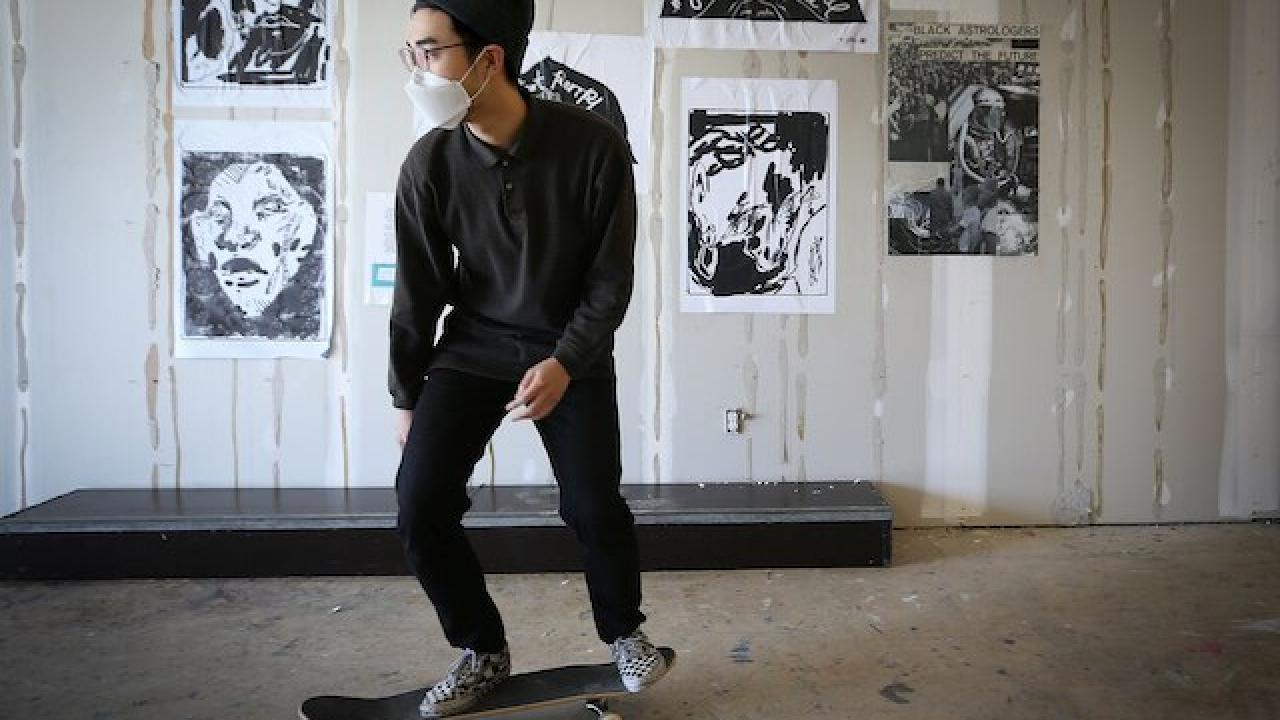 AAI communications assistant Jino Lee skating in the 1223 Vine Skate Park and Wheatpaste Gallery
