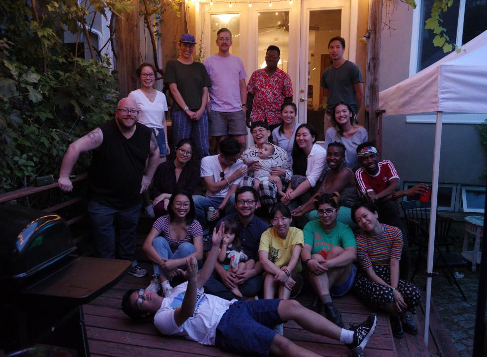 AAI's Diverse Staff and Friends gather for a group photo at a backyard party
