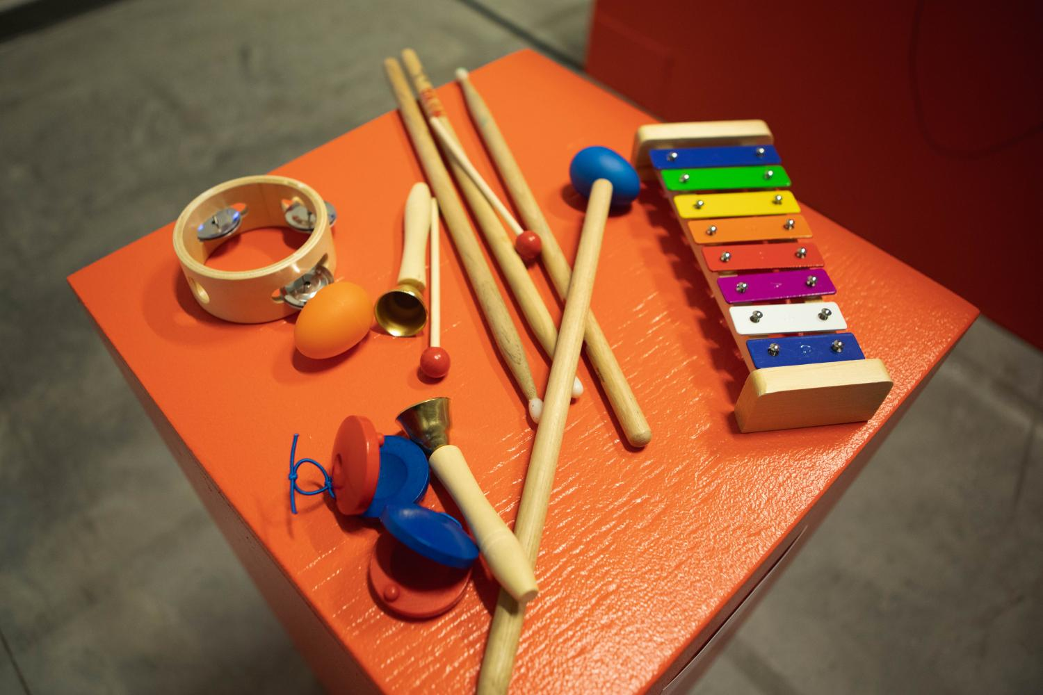 Percussion instruments on red surface