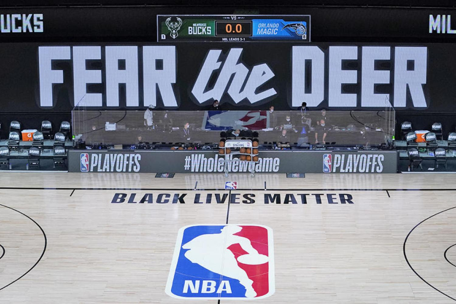 "Empty basketball court with text that read ""BLACK LIVES MATTER"""