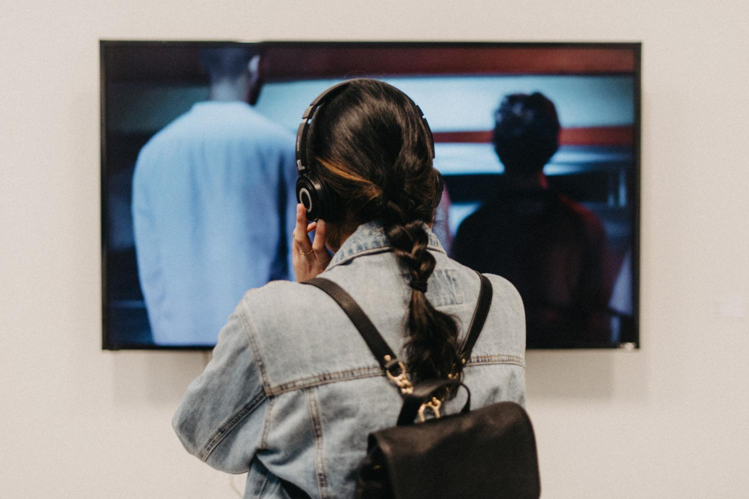 back of a person watching a television screen